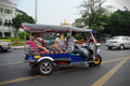 Tuk tuk taxi in bangkok a transports passengers on a road the khao san area on april thailand tuks can be hired from as Stock Images