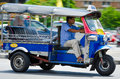 Tuk tuk tricycle thailand taxi running on the road in bangkok Stock Image