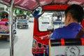 Tuktuk moving along a street in Bangkok, Thailand. Thai tuk tuk taxi on the road Royalty Free Stock Photo