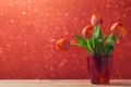 Tulip flowers bouquet over bokeh background Royalty Free Stock Photo