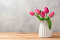 Tulip flowers bouquet on wooden table. Mothers day celebration Royalty Free Stock Photo