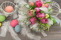 Tulip flowers with easter eggs vintage decoration style home birdcage Stock Images