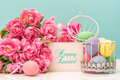 Tulip flowers and pastel colored easter eggs greetings card festive decoration with sample text happy Stock Photography