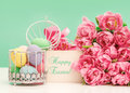 Tulip flowers and pastel coloredeaster eggs festive decoration with greetings card sample text happy easter Royalty Free Stock Photography