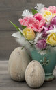 Tulip flowers with vintage easter eggs decoration colorful Stock Photos
