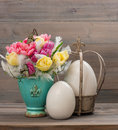 Tulip flowers with vintage easter eggs pastel colored decoration Royalty Free Stock Image