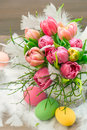 Tulip flowers with water drops vibrant colors fresh easter eggs festive decoration selective focus Stock Photo