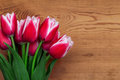 Tulips in the background of the board of wood Stock Photo
