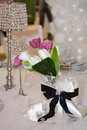 Tulips and crystal lamps decorating the table Royalty Free Stock Images