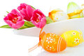 Tulips and easter eggs on white Royalty Free Stock Photo