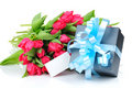 Tulips and gift with greeting card Royalty Free Stock Images