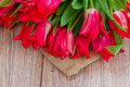 Tulips on wooden table Royalty Free Stock Photos