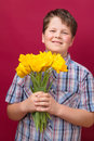 Tulips for you mom boy with yellow flowers his mother Royalty Free Stock Photo