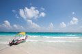 Tulum beach mexico with clear water and a motorboat Stock Photos