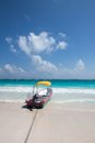 Tulum beach mexico with clear water and a motorboat Stock Image