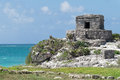 Tulum ruins by the caribbean sea ancient maya city of yucatan mexico Royalty Free Stock Image