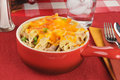 Tuna casserole in a stoneware crock with cheddar cheese Stock Images
