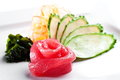 Tuna fish sashimi with cucumber on a white background