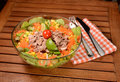 Tuna salad with carrots olives onion lettuce lime and tomato Stock Photo