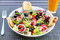 Tuna salad with tomatoes, black olives, rice, feta cheese and greens close up Royalty Free Stock Photo