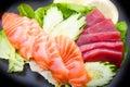 Tuna and salmon sashimi on black dish Royalty Free Stock Photo