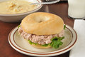 Tuna sandwich on a bagel with soup tunafish bowl of creamy potato Royalty Free Stock Image