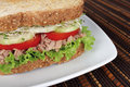 Tuna sandwich fresh with vegetables on white dish Royalty Free Stock Photo