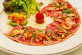 Tuna sashimi made in italian style cusine grill it is a mixer of two cultures Stock Photos
