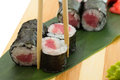 Tuna sushi roll on a wooden plate Royalty Free Stock Photos