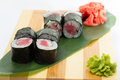 Tuna sushi roll on a wooden plate Royalty Free Stock Photography