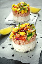 Tuna sushi stacks with mango, cucumber, tomatoes salsa served with balsamic vinegar, nigela ans sesame seeds Royalty Free Stock Photo