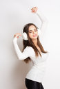 Tune in gorgeous young brunette enjoying music white headphones Royalty Free Stock Photos