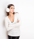 Tune in gorgeous young brunette enjoying music white headphones Stock Photography