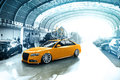 Royalty Free Stock Photography Tuned Audi S4 with yellow bike