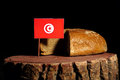 Tunisian flag on a stump with bread Royalty Free Stock Photo
