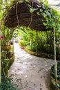 Tunnel shape walk way in butterfly garden Royalty Free Stock Photo