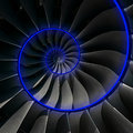 Turbine blades wings spiral blue neon glow effect abstract fractal pattern background. Spiral industrial production metallic turbi Royalty Free Stock Photo