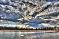 Turbulent pond a sky over a quiet near the chesapeake bay in maryland near sunset Stock Photography
