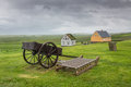 Turf houses in glaumbaer with cart iceland Royalty Free Stock Image