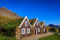 Turf houses row of three traditional icelandic on a sunny day Royalty Free Stock Image