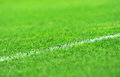Turf soccer field close up of a white painted stripe on a new Stock Image