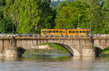 Turin old orange tram on a bridge the river po Royalty Free Stock Images