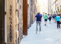 Turism in italy tuscany an art gallery signseen a street full of Royalty Free Stock Photography