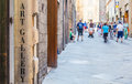 Turism in italy tuscany an art gallery signseen a street full of Royalty Free Stock Images