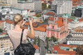 A turist taking a photo of the main city of Slovenia - Ljubljana Royalty Free Stock Photos