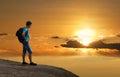 image photo : Tourist on mountain of gold sunset.