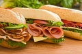 Turkey breast, ham & swiss and salami sandwiches Royalty Free Stock Photo