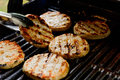 Turkey burgers on the grill Royalty Free Stock Photo