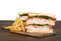 Turkey club sandwich with french fries Royalty Free Stock Photo
