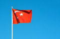 Turkey flag country waving over blue sky Royalty Free Stock Photo